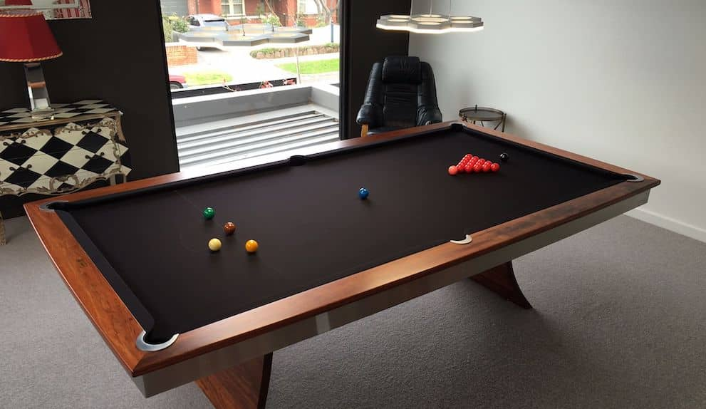 A black wood pool table made by the team at Quedos.