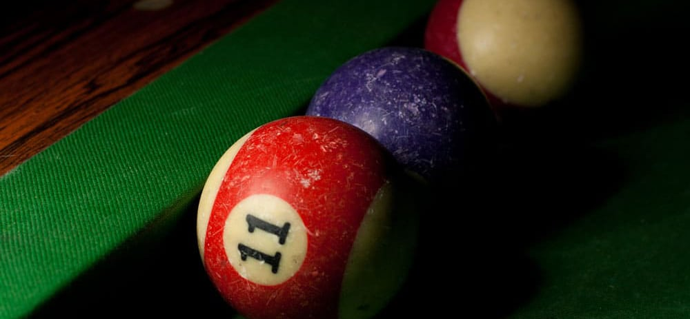 well used pool balls on table