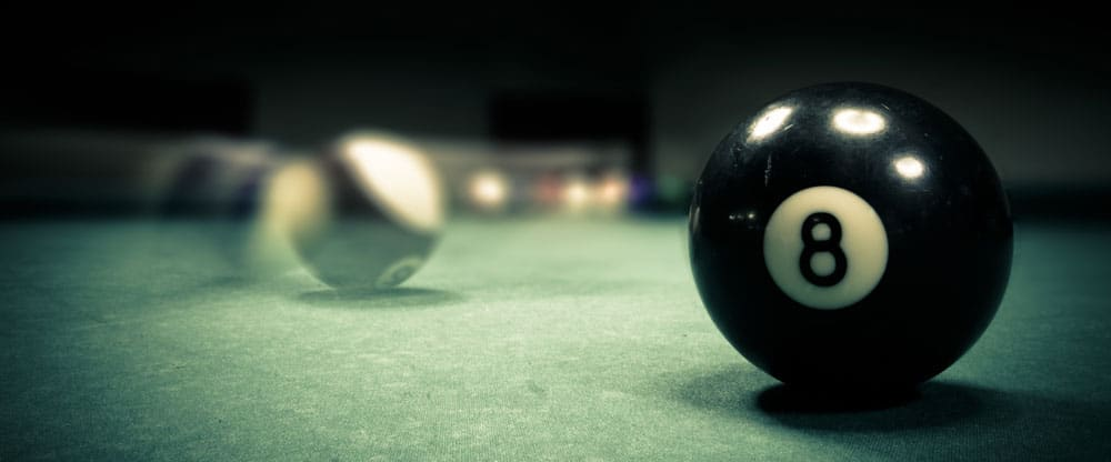 Pool balls in action on a table