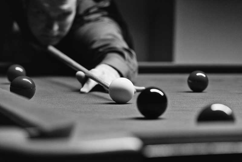 Game of snooker in black and white
