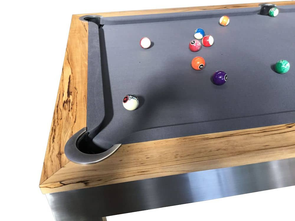 A corner of the visionary pool table with balls on it.