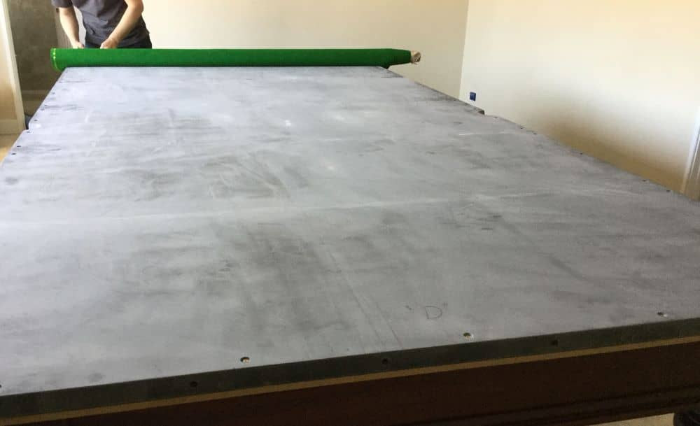 Smooth flat sheets of slate are ideal surfaces for pool tables.