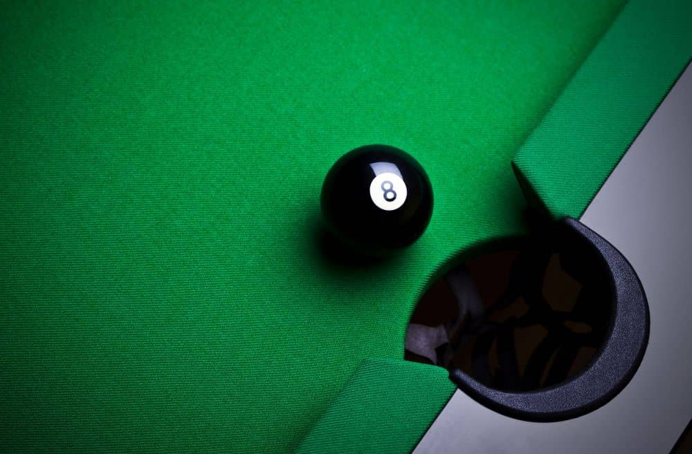 To win the pool game, you will need to pocket the number 8 ball after you have pocketed all seven balls.